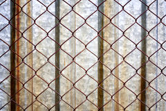 Rusty grunge metal background with grid Stock Image