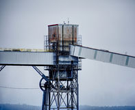 A rusty, grungy silo at a wharf against a gray sky. Taken in Seattle, Washington. Royalty Free Stock Photos