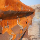 Rusty guard rail on rural road royalty free stock photo