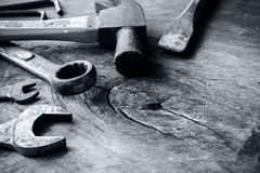 Rusty hammer and tools on old grunge wood background Royalty Free Stock Images