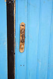 Rusty handle. On painted wooden gate Stock Images