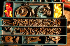 Rusty hardware in tray Royalty Free Stock Photos