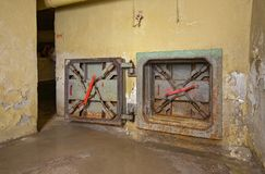 Rusty hatch emergency exit from the old underground shelter royalty free stock photo