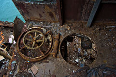 Rusty hatch with the steering wheel Inside rotten abandoned Russian warship Royalty Free Stock Photography