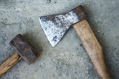 Rusty hatchet and hammer on a white background. A Rusty hatchet and hammer on a white background Stock Photos