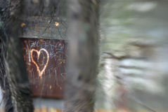 Rusty Heart. Rusty metal door to a bunker, with a heart tagged on it. The blur effect is achieved in-camera using a Lensbaby Stock Image