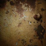 Rusty heart on rusty background