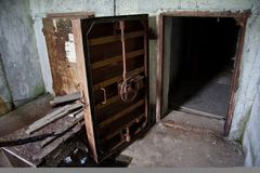 Rusty heavy steel hermetic door of the abandoned Soviet bomb shelter Stock Photography