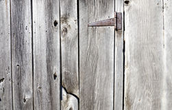 Rusty hinge on a barnboard door. A weathered and rusty hinge holds a barn door Royalty Free Stock Photography