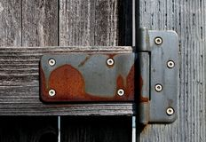 Rusty hinge creates textured pattern. Rusty hinge creating textured pattern with shallow depth of field yielding the unique design Stock Image