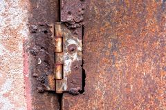 Rusty hinge welded steel on a rusty metal door texture background. Texture royalty free stock photo