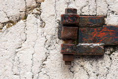 Rusty Hinge on white Rock Royalty Free Stock Photo