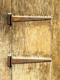 Rusty hinges on an old wooden door Royalty Free Stock Image