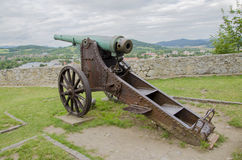 Rusty historic cannon. On meadow Royalty Free Stock Image