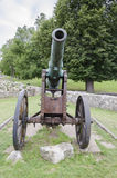 Rusty historic cannon. On meadow Stock Photo