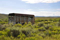 Rusty horse trailer on the prairie. A rusty old horse trailer sits on a prairie in Colorado Royalty Free Stock Image