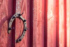 Rusty horseshoe hanging on barn wall royalty free stock image