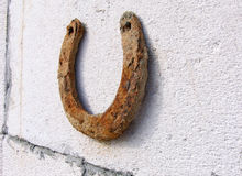 Rusty horseshoe on the wall Stock Photos