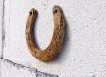 Rusty horseshoe on the wall Stock Photos