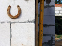 Rusty horseshoe on the wall Stock Photo