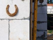 Rusty horseshoe on the wall Stock Photo