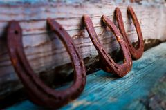 Rusty horseshoes decorative strung together royalty free stock photos