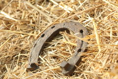 Rusty horseshoes on a straw background - rustic scene in a country style. Old iron Horseshoe - good luck symbol and mascot of well Stock Photo