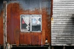 Rusty hovel in slum area in Thailand, house frontage and facade with rusty corrugated sheet and old wood Stock Photography
