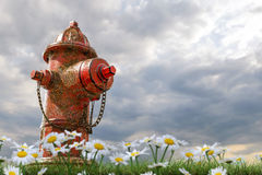 Rusty hydrant. 3d illustration of a rusty hydrant on green grass Stock Image