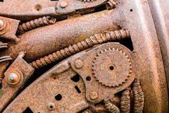 Rusty industrial cogwheel and other scratched parts of old machi Royalty Free Stock Images
