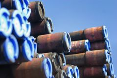 Ends of a stack of pipes covered with blue caps. Stock Photography