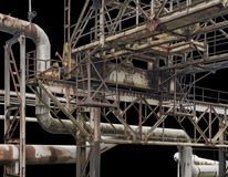 Rusty industrial scenery. Weathered rusty industrial scenery with old corroded tubes and steel girders in black back Royalty Free Stock Photos