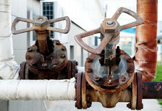 Rusty industrial tap water pipe and valve Royalty Free Stock Photos