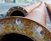 Rusty industrial water pipes Royalty Free Stock Images
