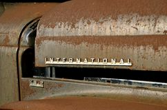 Rusty International truck logo. MANDAN, NORTH DAKOTA, July 1, 2016: The old pickup with an open hood and International logo is a product of the International stock images
