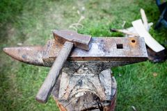 Rusty iron anvil and hammer Royalty Free Stock Image