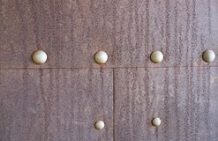 Rusty metal background with rivets for design. Rusty iron background with rivets for design royalty free stock photos