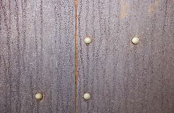 Rusty metal background with rivets for design. Rusty iron background with rivets for design royalty free stock image