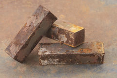 Rusty iron bar. Macro of three rusty iron bar stack over each other Royalty Free Stock Photos