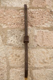 Rusty Iron Bar on Old Stone Wall Stock Photography