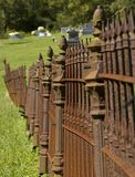Rusty Iron Cemetary Fence. Old rusty iron fence surrounding a cemetary stock photo