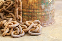 Rusty iron chain on concrete floor Royalty Free Stock Images