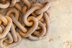 Rusty iron chain on concrete floor Royalty Free Stock Photo