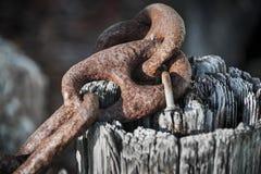 Rusty iron chain railing fragment Stock Photography