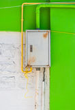 Rusty Iron Control Box on White and Green Concrete Wall Stock Images