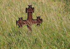 Rusty Iron Cross at Ancient Graveyard Stock Photo