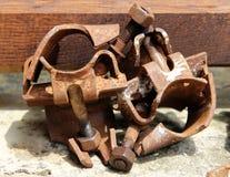 Rusty iron details with screws closeup Stock Photography