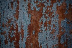Rusty iron door with cracked blue paint. Painted blue rusty wall shaped texture. Grunge rusty corrosive background painted blue. S. Teel plate background royalty free stock photos