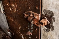 Rusty Iron door on a concrete wall. Rusty Iron door inside a World War 2 bunker monument Stock Photography