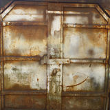 Rusty iron doors. Rusty old iron doors closeup background Royalty Free Stock Photo